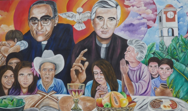 A mural in El Paisnal, El Salvador, features Blessed Oscar Romero and town native Father Rutilio Grande, surrounded by rural men, women and children, the community the Jesuit Father Grande served from 1972 until his March 12, 1977, assassination. (CNS/Rhina Guidos)