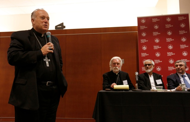 Bishop Robert W. McElroy of San Diego comments at a public session held during the March 7-8 National Catholic-Muslim Dialogue in Chicago. (CNS/Karen Callaway, Chicago Catholic)