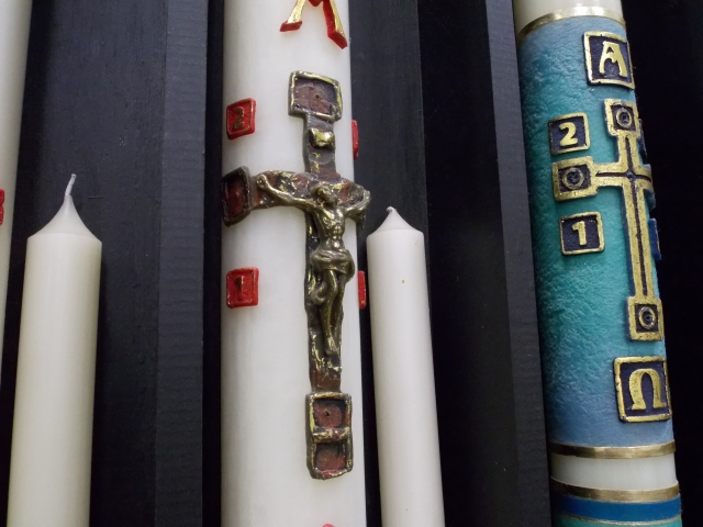 A wax crucifix graces the center of a paschal candle March 10 at the A.I. Root Co. in Medina, Ohio. The candles are made to order and shipped to churches across the United States. (CNS/Katie Breidenbach)