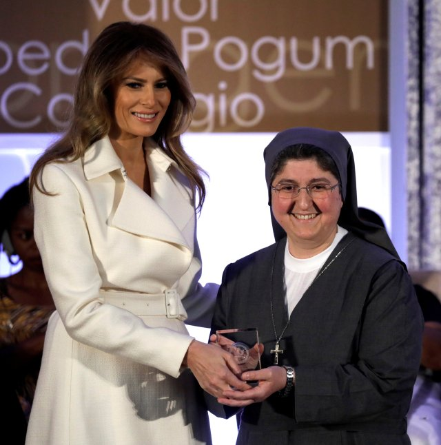 First lady Melania Trump presents Sister Carolin Tahhan Fachakh of Syria with the 2017 Secretary of State's International Women of Courage Award during a March 29 ceremony at the State Department in Washington. (CNS/Reuters)