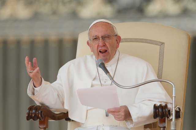 Pope Francis speaks during his general audience in St. Peter's Square at the Vatican April 5. (CNS/Paul Haring)