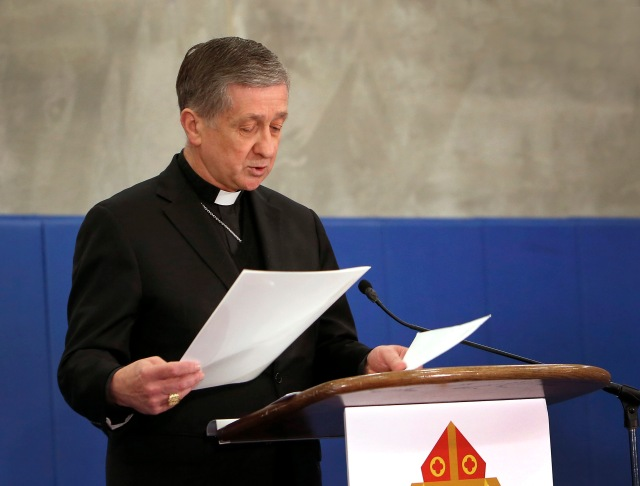 Cardinal Blase J. Cupich of Chicago reads a letter from Pope Francis to the people of Chicago April 4 after announcing an anti-violence initiative to increase the capacity and reach of current programs of the Chicago Archdiocese that address the root causes of violence. (CNS/Karen Callaway, Chicago Catholic)
