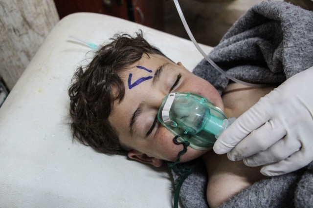 A child receives treatment inside a field hospital in Idlib, Syria, after the April 4 chemical attack.(CNS/EPA)