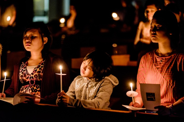 Young people hold candles during the Easter Vigil in 2015 at the Cathedral of St. Joseph in Hartford, Conn. (CNS/Bob Mullen)