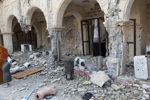 Mannequins that were used by Islamic State militants for target practice are seen April 3 in the courtyard of the destroyed Immaculate Conception Church in Qaraqosh, Iraq. (CNS/courtesy John E. Kozar, CNEWA)