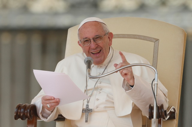 Pope Francis speaks during his general audience in St. Peter's Square at the Vatican April 12. (CNS/Paul Haring)