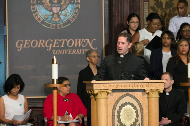 "Jesuit Father Timothy Kesicki, president of the Jesuit Conference of Canada and the United States, delivers the homily at an April 18 ""Liturgy of Remembrance, Contrition and Hope"" in Gaston Hall on the campus of Georgetown University in Washington. (CNS/Jaclyn Lippelmann, Catholic Standard)"