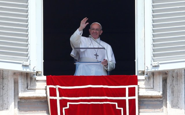 """Pope Francis waves as he leads the """"Regina Coeli"""" from his studio overlooking St. Peter's Square at the Vatican April 23, Divine Mercy Sunday. (CNS/Reuters)"""