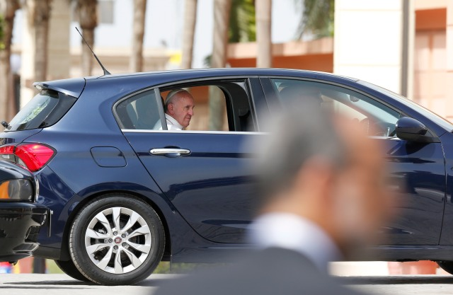 Pope Francis leaves the international airport in Cairo April 28. The pope was making a two-day visit to Egypt. (CNS/Paul Haring)