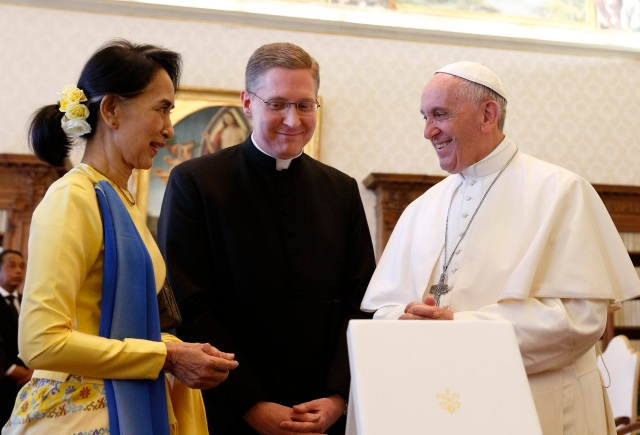 Pope Francis exchanges gifts with Aung San Suu Kyi, leader of Myanmar, during a private audience at the Vatican May 4. (CNS photo/Paul Haring)