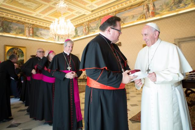 "Pope Francis greets Cardinal Gerald Lacroix of Quebec as he meets with Canadian bishops from Quebec during their ""ad limina"" visits to the Vatican May 11. (CNS/L'Osservatore Romano)"