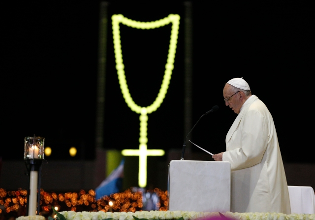 Pope Francis leads a vigil in the Little Chapel of the Apparitions at the Shrine of Our Lady of Fatima in Portugal May 12. (CNS/Paul Haring)