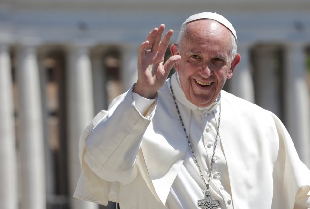 Pope Francis waves as he arrives for his general audience in St. Peter's Square May 17. (CNS/Reuters)