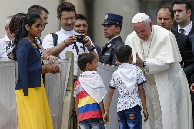Pope Francis greets children during his general audience in St. Peter's Square at the Vatican May 24. (CNS/Reuters)