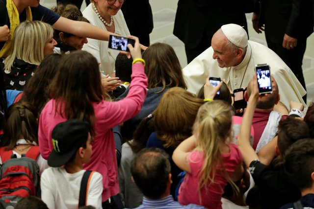 "Pope Francis poses for a selfie as he arrives to lead a special audience for members of a middle school group June 2 at the Vatican. The middle-schoolers were part of Communion and Liberation's ""The Knights of the Grail"" educational initiative. (CNS/Reuters)"