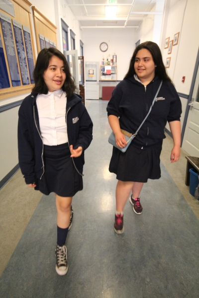 Elizabeth and her best friend, Evangelina Tapio, eighth-graders at St. Andrew Nativity School in Portland, Ore., walk to class. (CNS/Katie Scott, Catholic Sentinel)