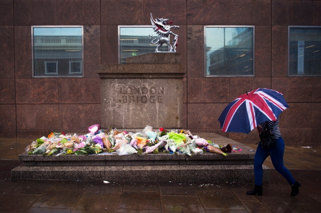 A person walks past a memorial for victims of the London Bridge terror attacks in London, June 6. (CNS/EPA)