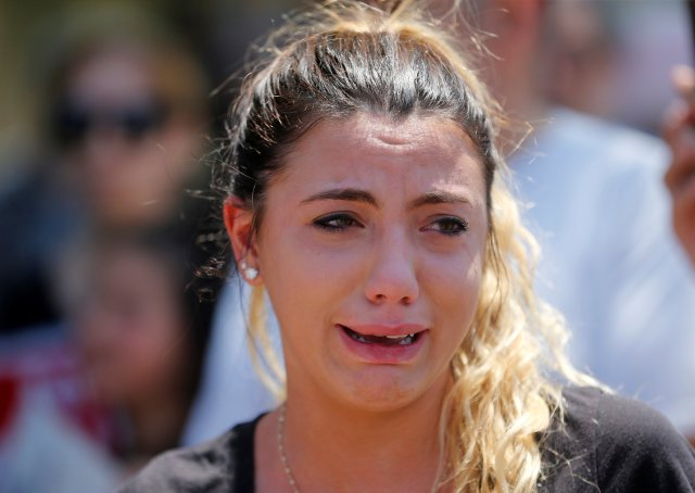 Chaldean-American Lavrena Kenawa cries during a June 12 rally outside the Mother of God Chaldean Catholic Church in Southfield, Mich. Her uncle was among dozens of Chaldean Christians who were arrested by federal immigration officials over the weekend of June 10 and 11 in the Detroit metropolitan area. (CNS/Reuters)