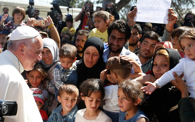 Pope Francis meets refugees at the Moria refugee camp on the island of Lesbos, Greece, in 2016. (CNS photo/Paul Haring)