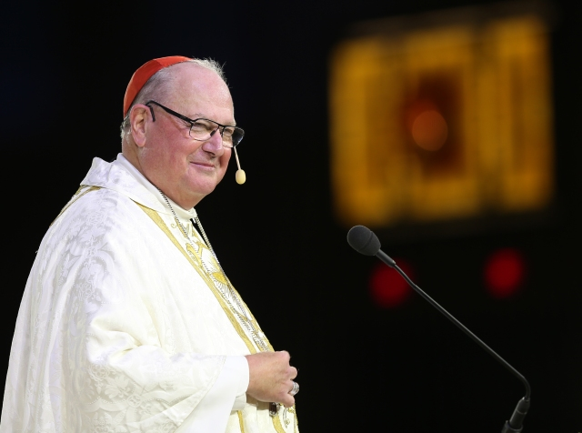 "Cardinal Timothy M. Dolan of New York smiles as he delivers the homily during the opening Mass of the ""Convocation of Catholic Leaders: The Joy of the Gospel in America"" July 1 in Orlando, Fla. (CNS/Bob Roller)"
