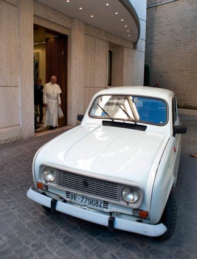 """A white 1984 Renault that Father Renzo Zocca donated to Pope Francis in 2013 highlights the importance of """"a poor church for the poor."""" The Italian priest put more than 180,000 miles on the car, ministering to drug addicts and the poor. Pope Francis told the priest he had the same make and model when he worked in Buenos Aires, Argentina, and it """"never let him down."""" (CNS/L'Osservatore Romano via Catholic Press Photo)"""