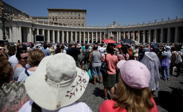 Pilgrims listen as Pope Francis leads the Angelus July 9 in St. Peter's Square at the Vatican. (CNS/Reuters)