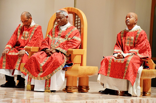 Cardinal Peter Turkson, prefect of the Vatican's Dicastery for Promoting Integral Human Development, center, celebrates the July 6 opening Mass of the 12th National Black Catholic Congress in Orlando, Fla. (CNS/Andrea Navarro, Florida Catholic)