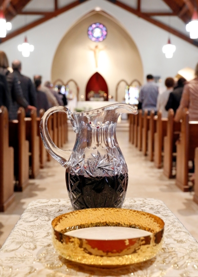 A ciborium containing hosts and a flagon of wine are seen during Mass this year at St. Therese of Lisieux Church in Montauk, N.Y. Bishops should look at ways to help verify and guarantee the validity and worthiness of the bread and wine used for the celebration of the Eucharist, the Vatican said in a recent document. (CNS photo/Gregory A. Shemitz, Long Island Catholic)