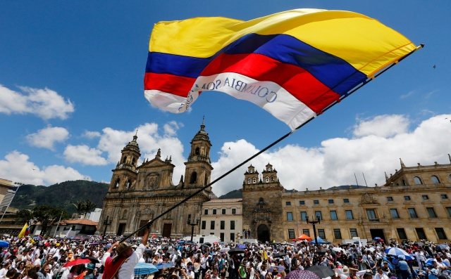 A man waves a Colombian flag in Bogota, Colombia, in this 2015 file photo. Pope Francis will beatify Bishop Jesus Emilio Jaramillo Monsalve of Arauca and Father Pedro Ramirez Ramos in the South American country Sept. 8. (CNS/Reuters)
