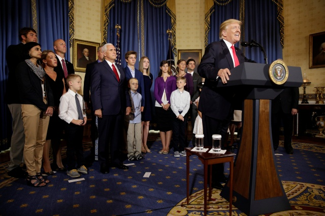 President Donald Trump talks about health care reform in the Blue Room of the White House in Washington July 24. (CNS/Reuters)