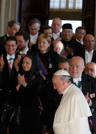Pope Francis leaves a meeting with ambassadors to the Holy See in 2014. (CNS/Paul Haring)