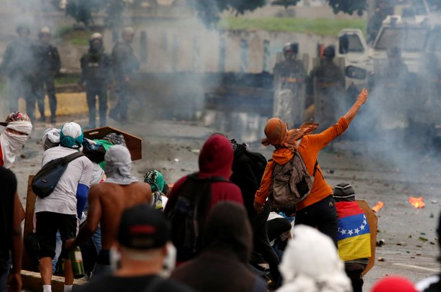 Demonstrators clash with riot security forces while rallying against Venezuela President Nicolas Maduro's government July 28 in Caracas. (CNS/Reuters)