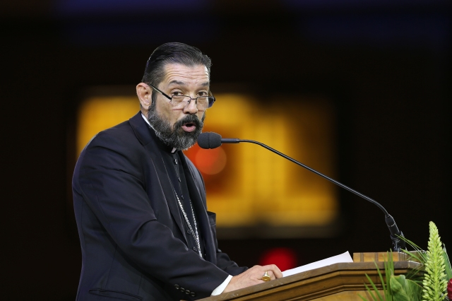 "Bishop Daniel Flores of Brownsville, Texas,, speaks during eucharistic adoration at the ""Convocation of Catholic Leaders: The Joy of the Gospel in America"" July 2 in Orlando, Fla. (CNS/Bob Roller)"