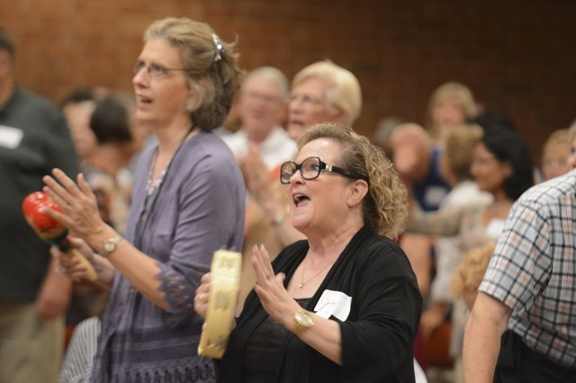 Carla Murphy and Joie Murray, members of the local Catholic Charismatic Renewal in Nashville, Tenn., pray during the Mercy Rally held in 2016 at St. Ignatius of Antioch Church in Nashville. The Catholic Charismatic Renewal marks the 50th anniversary of its founding this year. (CNS/Andy Telli, Tennessee Register)