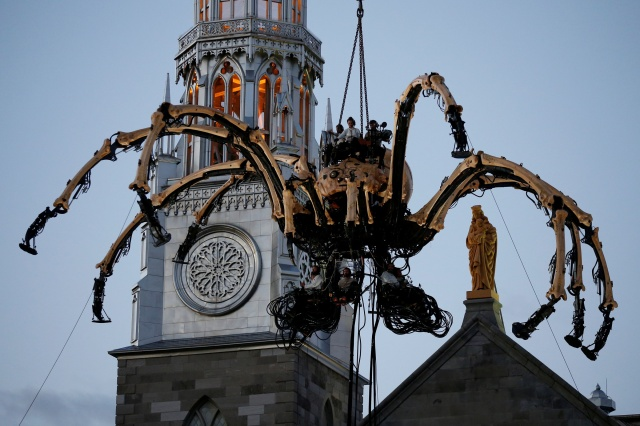 A giant mechanical spider is seen during an art performance in front of Notre-Dame Cathedral Basilica in Ottawa July 27. (CNS/Reuters)