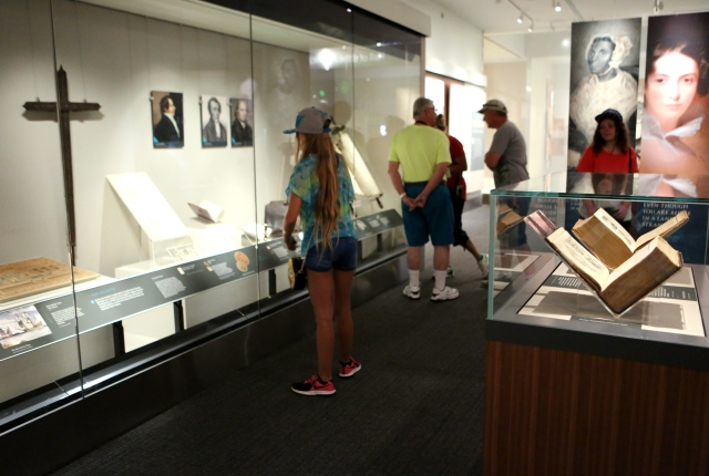 """Visitors at the Smithsonian Institution's National Museum of American History in Washington check out the exhibit """"Religion in Early America."""" The exhibit will be on display until June 3, 2018. (CNS photo/Chaz Muth)"""