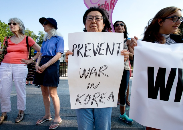 Nuclear war protesters demonstrate outside the White House in Washington Aug. 9. Church officials called for dialogue to ease U.S.-North Korea tensions. (CNS/Tyler Orsburn)