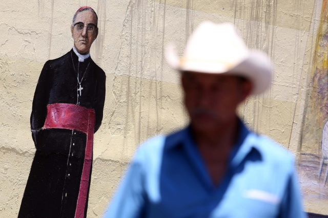 A painting of Blessed Oscar Romero is seen on a wall in San Salvador, El Salvador, March 24. (CNS/EPA)