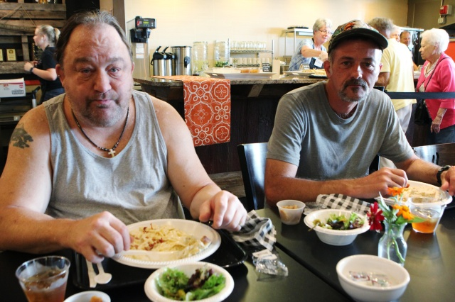 Ken Ahrens and Robbie Floriana, both of Port Clinton, Ohio, and unemployed, joined the free community meal offered by Bistro 163 Aug. 14. (CNS/Dennis Sadowski)