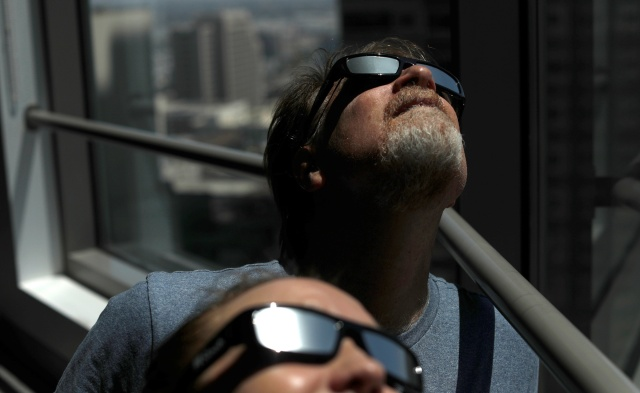 People will be wearing solar-eclipse sunglasses like these across the United States Aug. 21. (CNS/Reuters)