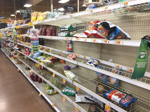 The chip aisle of a Kroger grocery store is sparse as people prepare for Hurricane Harvey Aug. 24 in Houston. (CNS/James Ramos, Texas Catholic Herald)