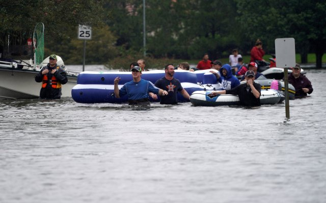 People are evacuated by volunteers in waist-deep floodwaters from Tropical Storm Harvey Aug. 29 in Houston. (CNS/Reuters)