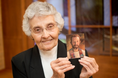 Sister Marita Rother holds a picture of her brother, Father Stanley Rother, a priest of the Oklahoma City Archdiocese, who will be beatified Sept. 23 in Oklahoma City. (CNS/Christopher Riggs, Catholic Advance)