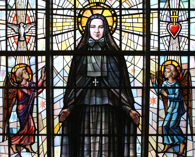 St. Frances Xavier Cabrini is depicted in a stained-glass window at the saint's shrine chapel in the Washington Heights section of New York City. Her remains rest in a glass casket under the altar in the shrine. (CNS file/Gregory A. Shemitz)