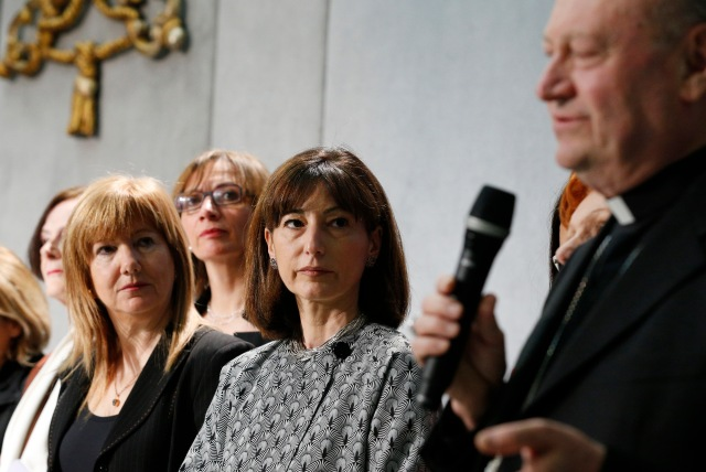 Cardinal Gianfranco Ravasi, president of the Pontifical Council for Culture, and women who are consultants to the council, attend a media event at the Vatican March 7. A group of 37 female consultants from around the world advise the council on matters ranging from neuroscience to sports. (CNS/Paul Haring)
