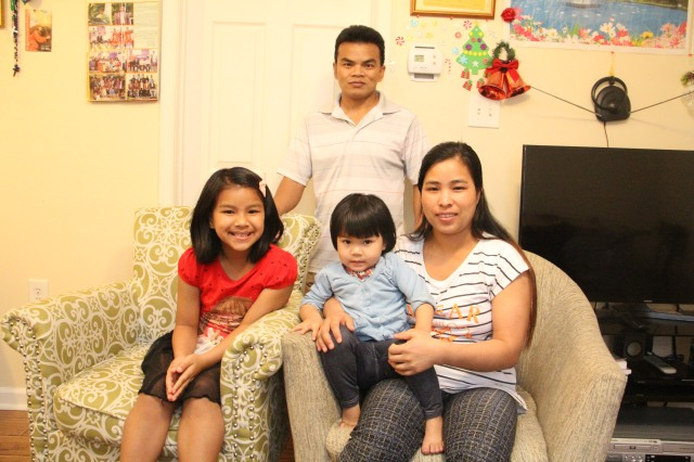 Pa Tin, 42, his wife Biak Hlei Iang, 34, and their children 8-year-old Rebecca Rem Chin Par and 2-year-old Van Dawt Sung, moved from Myanmar to Ranson, W.Va., in 2016. (CNS/John Sherwood, The Catholic Spirit)