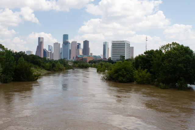 Houston's skyline is seen as Buffalo Bayou floods past its banks near downtown Houston Aug. 31 in the aftermath of Tropical Storm Harvey. (CNS/James Ramos, Texas Catholic Herald)