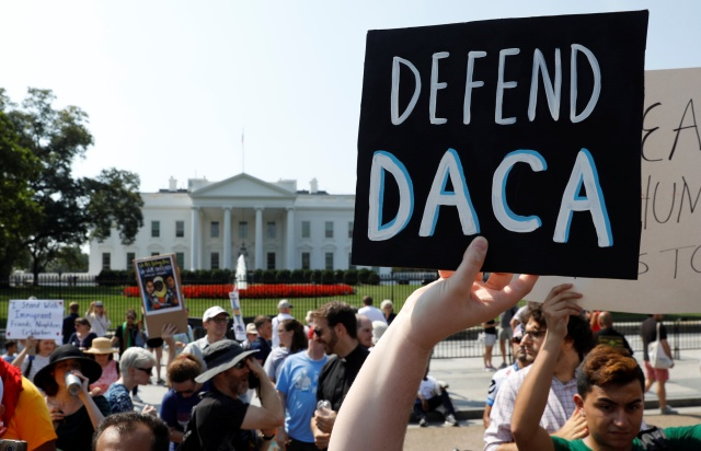 "Deferred Action for Childhood Arrivals supporters demonstrate near the White House in Washington Sept. 5 as U.S. Attorney General Jeff Sessions announced that the DACA program is ""being rescinded"" by President Donald Trump. (CNS/Reuters)"