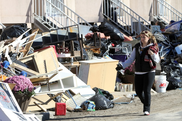 Mounds of debris are seen outside homes in Long Beach, N.Y., six days after Superstorm Sandy pounded the community in October 2012.  Measures to allow houses of worship to apply for FEMA aid after disasters were first introduced in the House and Senate back in 2013, months after Superstorm Sandy. (CNS/Gregory A. Shemitz)