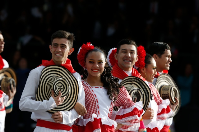 Colombian dancers in traditional dress wait for Pope Francis upon his arrival in Bogota, Colombia, Sept. 6. (CNS/Paul Haring)